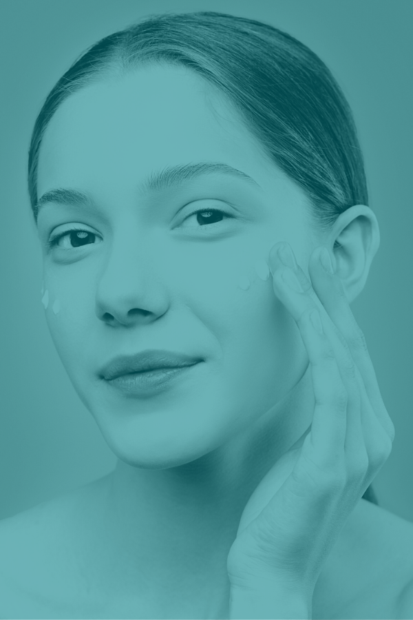 Image of a woman putting moisturizer on her face as part of cosmetics market research