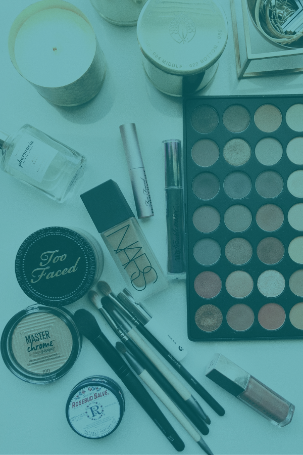 Image of beauty products arranged around a purse in cosmetics market research display